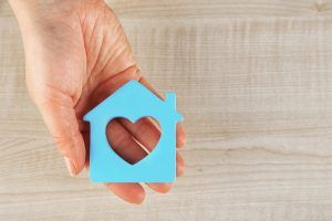 HomeCare vs HomeHealth blue house with a heart in the middle